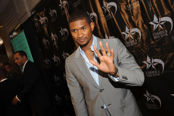 Usher cleans his own restaurant cutlery