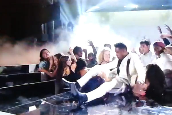 Miguel lands on woman after trying to jump over crowd