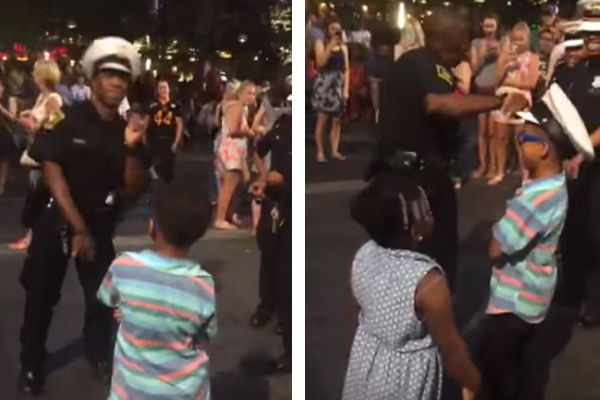 Little boy challenges cop to a dance off and the result is EPIC!
